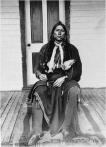 Quanah Parker seated on the porch of the Star House
