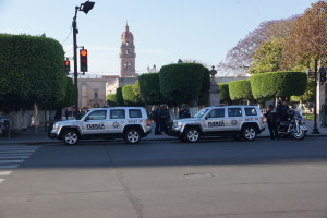 Police cars stationed around a park in Morelia, Michoacan.